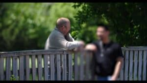 men talking outside abortion mill