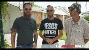 men outside an abortion mill