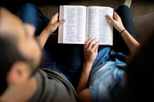 couple reading to see what does the bible say about abortion.