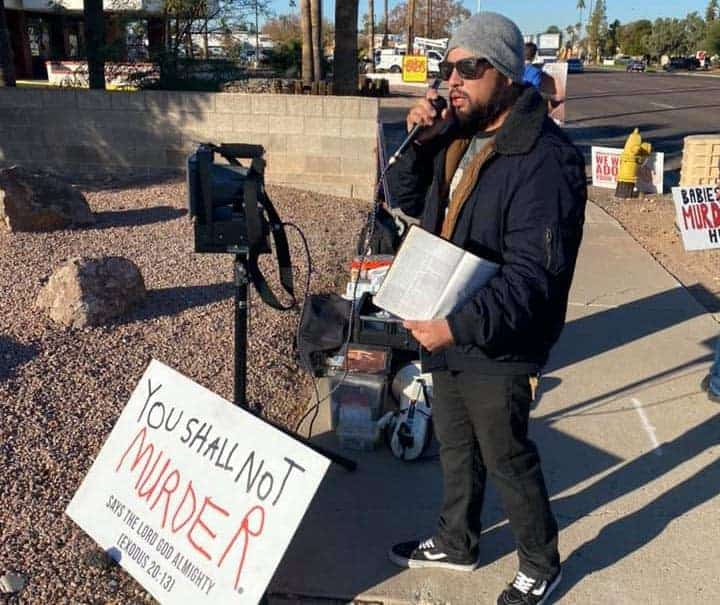 preaching the gospel outside of planned parenthood.